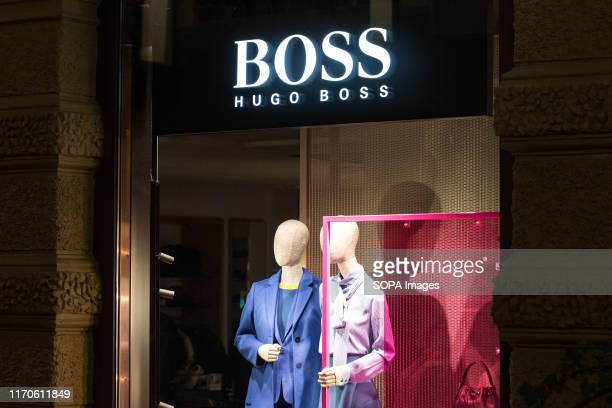 Hugo Boss logo seen in Gothenburg. Hugo Boss AG, often styled as BOSS, is a luxury fashion house headquartered in Metzingen, Germany.
