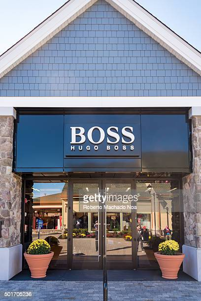 Hugo Boss store in New York USA with its signage on facade Hugo Boss AG is a German luxury fashion and style house based in Metzingen Germany It is...