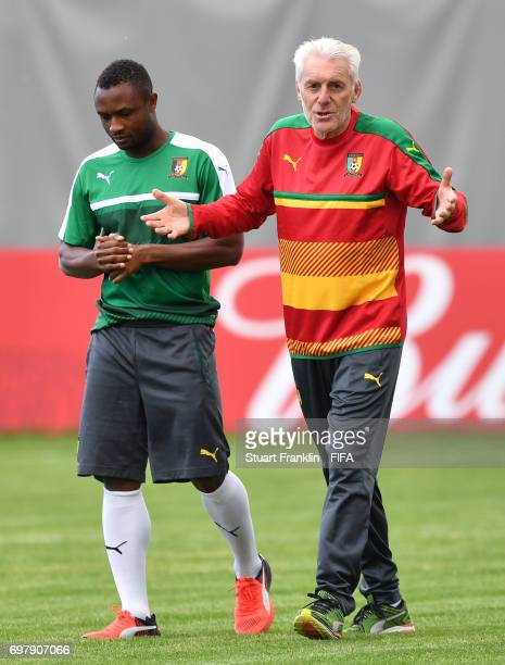 Hugo Broos head coach of Cameroon talks with a player during a training session of the Cameroon national football team on June 19 2017 in Saint...