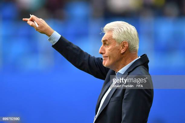 Hugo Broos head coach of of Cameroon gives his team instructions during the FIFA Confederations Cup Russia 2017 Group B match between Cameroon and...