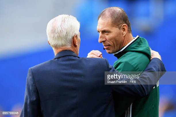 Hugo Broos head coach of of Cameroon speaks to the fourth offical during the FIFA Confederations Cup Russia 2017 Group B match between Cameroon and...