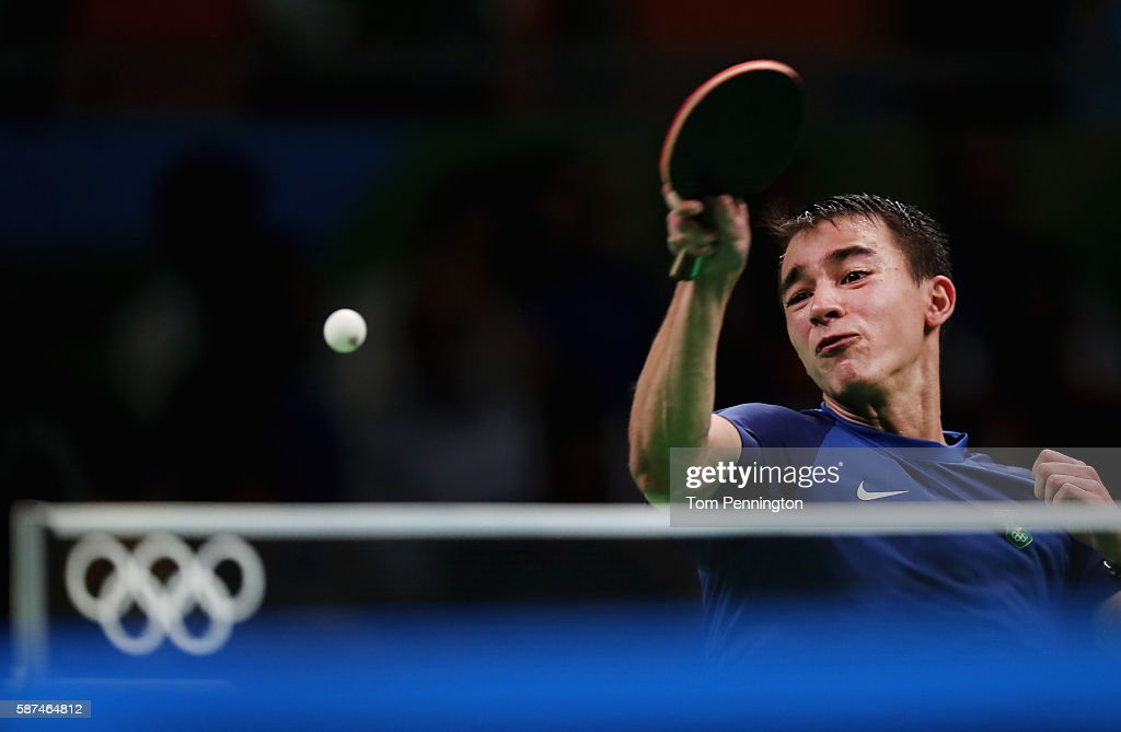 Hugo Calderano of Brazil competes against Jun Mizutani of Japan during Round 4 of the Men's Singles Table Tennis on Day 3 of the Rio 2016 Olympic Games at Riocentro - Pavilion 3 on August 8, 2016 in Rio de Janeiro, Brazil.