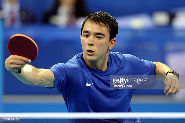 Hugo Calderano of Brazil in action against Yang Heng Wei of Chinese Taipei during Day Four of the Nanjing 2014 Summer Youth Olympic Games Boys Table...