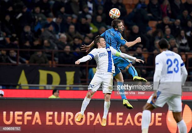 Hugo Campagnaro of FC Internazionale and Ruslan Rotan of FC Dnipro compete for the ball during the UEFA Europa League Group F match between FC...