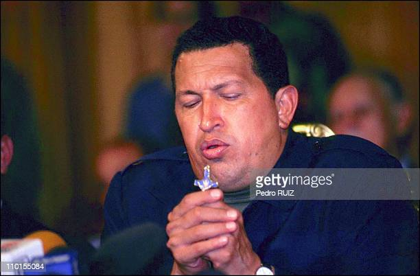 Hugo Chavez returns to palace of Miraflores after spending 48 hours in custody of the military in Caracas Venezuela on April 13 2002