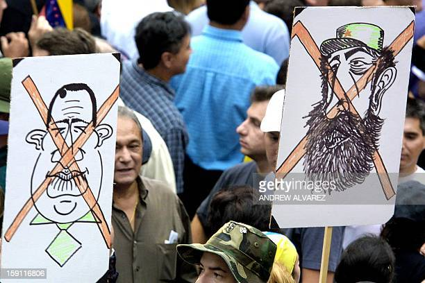 Hugo Chavez's opposition hold posters of him and Fidel Castro during a protest in Caracas 26 September 2002 before the mass for peace is held The...
