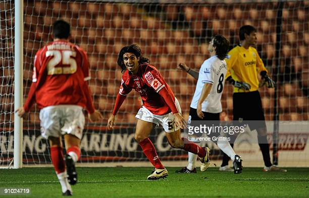 Hugo Colace of Barnsley celebrates scoring the third goal during the Carling Cup Third Round game between Barnsley and Burnley at Oakwell on...