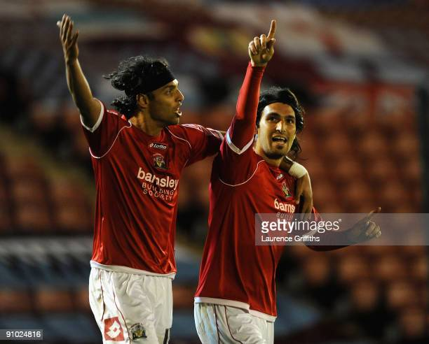 Hugo Colace of Barnsley celebrates scoring the third goal for his team with teammate Anderson De Silva during the Carling Cup Third Round game...