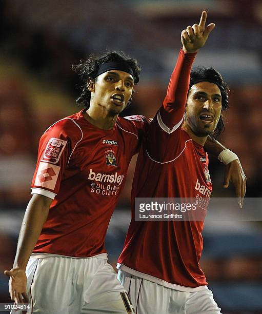 Hugo Colace of Barnsley celebrates with Anderson De Silva after scoring the third goal during the Carling Cup Third Round game between Barnsley and...