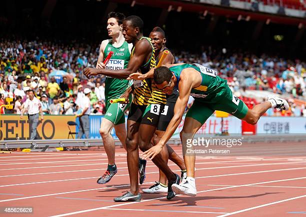 Hugo De Sousa of Brazil collides with Javon Francis of Jamaica in the Men's 4x400 Metres Relay heats during day eight of the 15th IAAF World...
