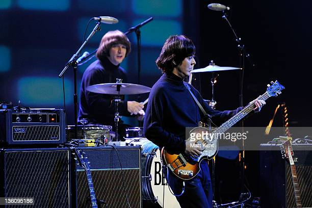 Hugo Degenhardt and David CatlinBirch of The Bootleg Beatles perform on stage at HMV Hammersmith Apollo on December 19 2011 in London United Kingdom