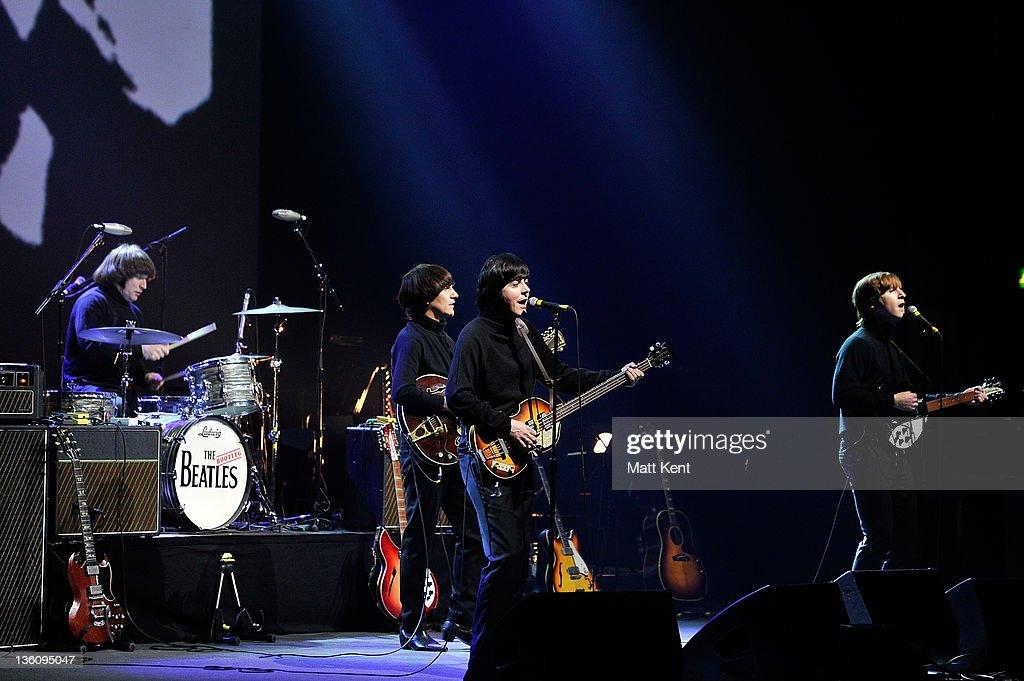 Hugo Degenhardt (Ringo Star), Andre Barreau (George Harrison), David Catlin-Birch (Paul McCartney) and Adam Hastings (John Lennon) of The Bootleg Beatles perform on stage at HMV Hammersmith Apollo on December 19, 2011 in London, United Kingdom.