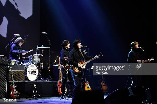 Hugo Degenhardt Andre Barreau David CatlinBirch and Adam Hastings of The Bootleg Beatles perform on stage at HMV Hammersmith Apollo on December 19...