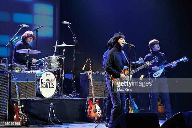 Hugo Degenhardt David CatlinBirch and Adam Hastings of The Bootleg Beatles perform on stage at HMV Hammersmith Apollo on December 19 2011 in London...