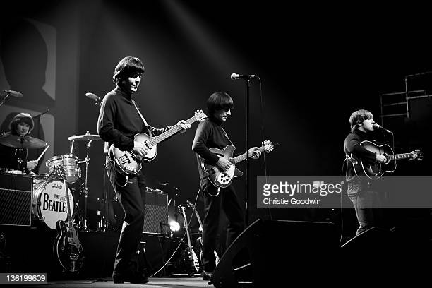 Hugo Degenhardt David CatlinBirch Andre Barreau and Adam Hastings of The Bootleg Beatles perform on stage at the Hammersmith Apollo on December 19...