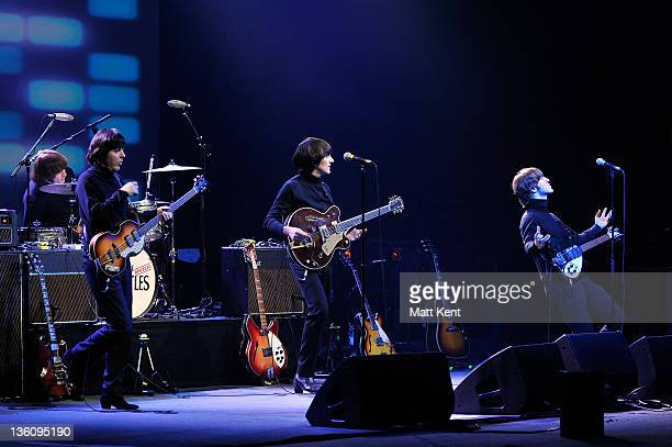Hugo Degenhardt David CatlinBirch Paul McCartney Andre Barreau and Adam Hastings of The Bootleg Beatles perform on stage at HMV Hammersmith Apollo on...