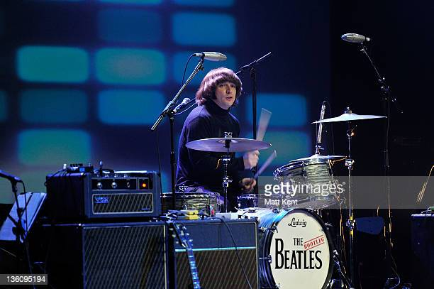 Hugo Degenhardt of The Bootleg Beatles performs on stage at HMV Hammersmith Apollo on December 19 2011 in London United Kingdom