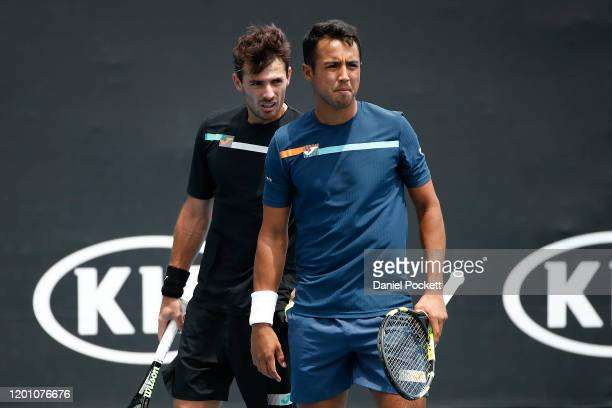 Hugo Dellien of Bolivia and Juan Ignacio Londero of Argentina talk tactics during their Men's Doubles first round match against Marcelo Arevalo of El...