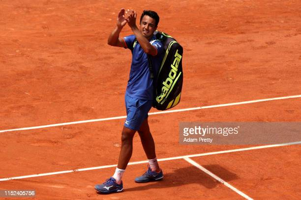 Hugo Dellien of Bolivia applauds fans following defeat during his mens singles second round match against Stefanos Tsitsipas of Greece during Day...
