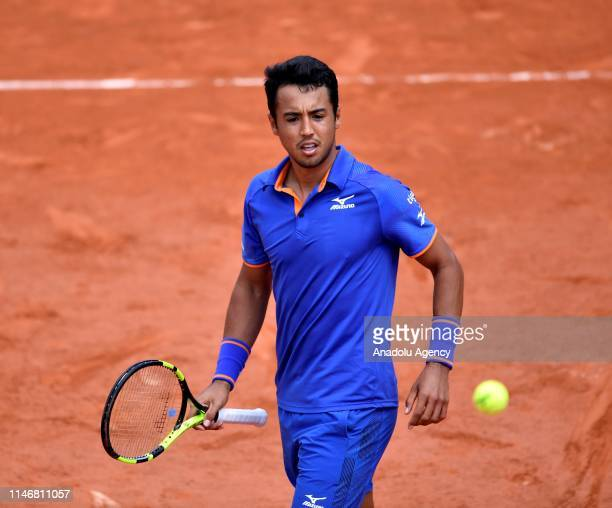 Hugo Dellien of Bolivia in action against Stefanos Tsitsipas of Greece during their second round match at the French Open tennis tournament at Roland...
