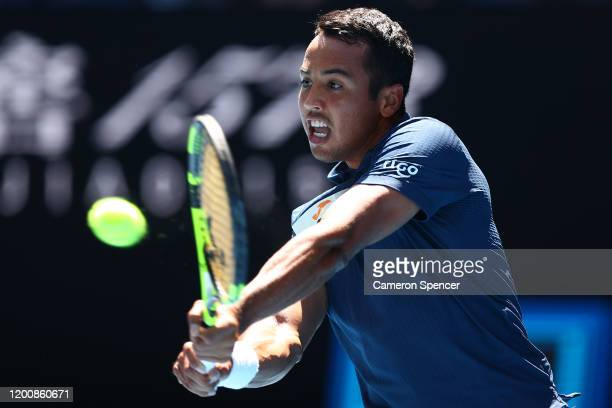 Hugo Dellien of Bolivia plays a backhand during his Men's Singles first round match against Rafael Nadal of Spain on day two of the 2020 Australian...