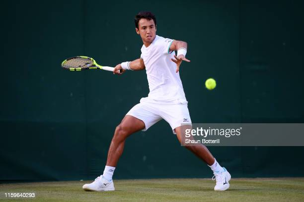 Hugo Dellien of Bolivia plays a forehand in his Men's Singles first round match against John Millman of Australia during Day two of The Championships...