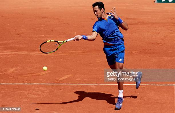 Hugo Dellien of Bolivia returns a shot in his mens singles second round match against Stefanos Tsitsipas of Greece during Day four of the 2019 French...
