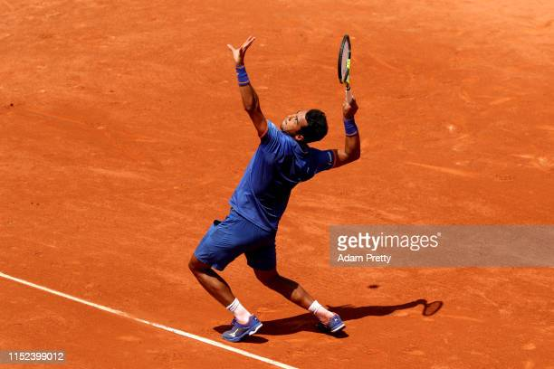 Hugo Dellien of Bolivia serves during his mens singles second round match against Stefanos Tsitsipas of Greece during Day four of the 2019 French...
