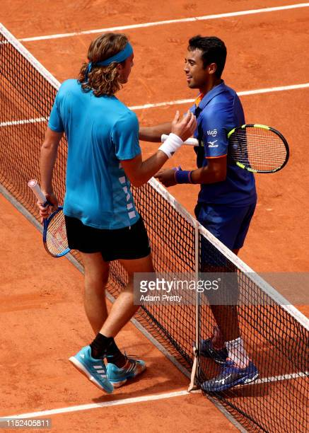 Hugo Dellien of Bolivia shakes hands with Stefanos Tsitsipas of Greece after their mens singles second round match during Day four of the 2019 French...
