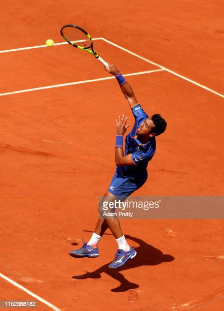 Hugo Dellien of Bolivia volleys during his mens singles second round match against Stefanos Tsitsipas of Greece during Day four of the 2019 French...