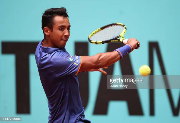Hugo Dellien of Bolvia in action against Kei Nishikori of Japan during day five of the Mutua Madrid Open at La Caja Magica on May 08, 2019 in Madrid,...