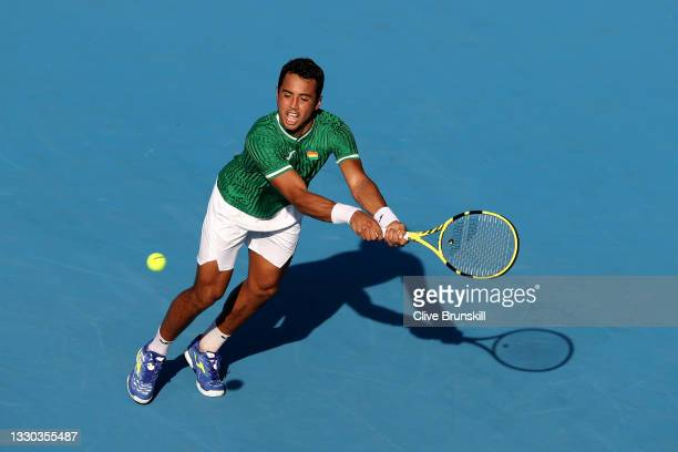 Hugo Dellien of Team Bolivia plays a backhand during his Men's Singles First Round match against Novak Djokovic of Team Serbia on day one of the...