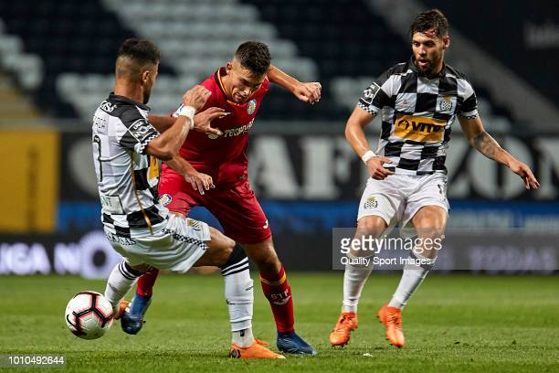 Hugo Duro of Getafe CF is challenged by Rui Filipe Caetano 'Carraça' of Boavista CF during the Preseason friendly match between Boavista FC and...