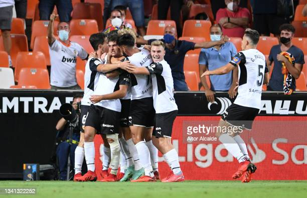 Hugo Duro of Valencia celebrates with teammates after scoring their side's first goal during the La Liga Santander match between Valencia CF and Real...