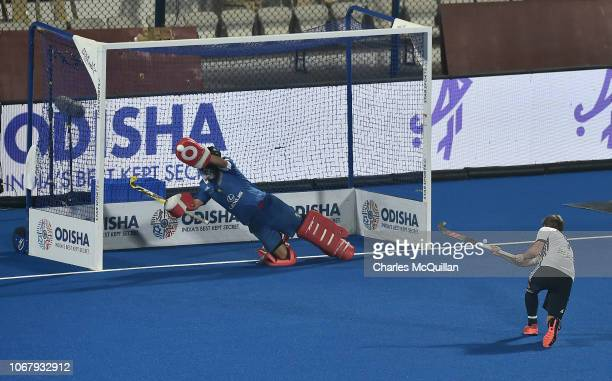 Hugo Genestet of France has a penalty saved by Quico Cortes of Spain during the FIH Men's Hockey World Cup Pool A match between Spain and France at...