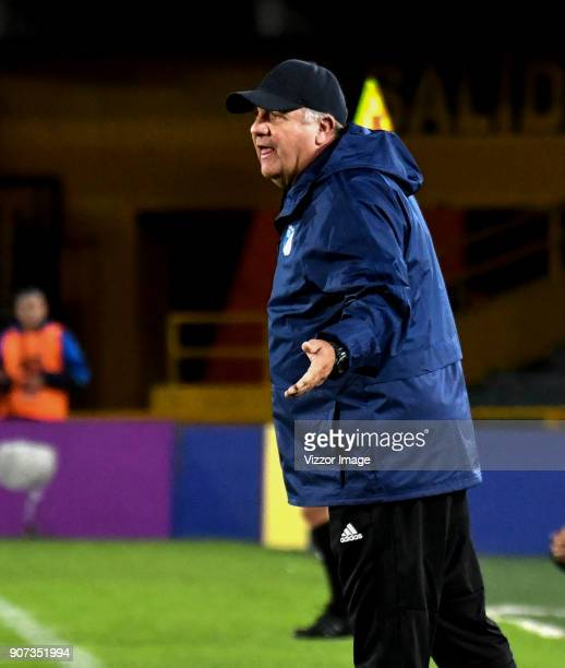Hugo Gotardi coach of Millonarios gives instructions to his players during the friendly match between Millonarios and America de Cali as par of the...