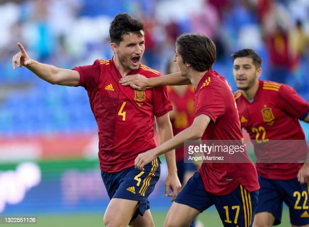 Hugo Guillamon of Spain U21 celebrates with Bryan Gil after scoring the opening goal during the international friendly match between Spain U21 and...