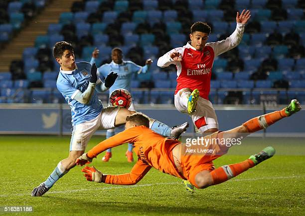 Hugo Keto and Chiori Johnson of Arsenal stop Brahim Diaz of Manchester City during the FA Youth Cup Semi Final First Leg match between Manchester...