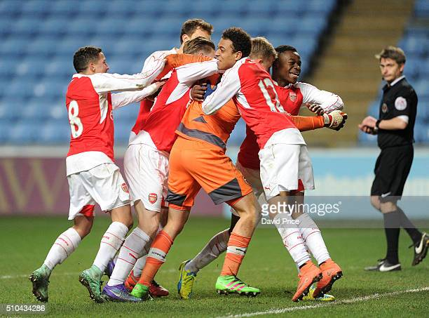 Hugo Keto is congratulated by his team mates including Marc Bola and Donyel Malen after the penalty shoot out during the match between Coventry City...