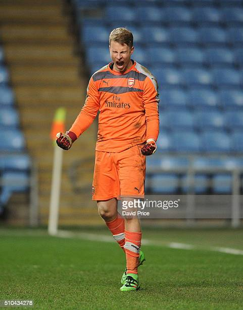 Hugo Keto of Arsenal celebrates making a save in the penalty shoot out during the match between Coventry City v Arsenal in the FA Youth Cup at Ricoh...