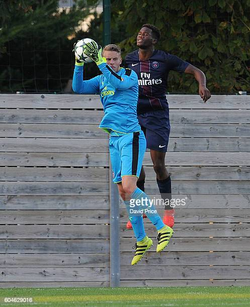 Hugo Keto of Arsenal is challenged by Samuel Essende of PSG during the UEFA Champions League match between Paris SaintGermain and Arsenal at Stade...