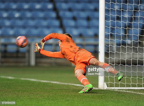 Hugo Keto of Arsenal makes a save in the penalty shoot out during the match between Coventry City v Arsenal in the FA Youth Cup at Ricoh Arena on...