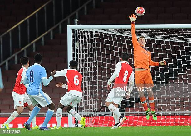Hugo Keto of Arsenal tips Rodney Kongolo of Man City shot over the bar during the match between Arsenal U18 and Manchester City U18 at Emirates...