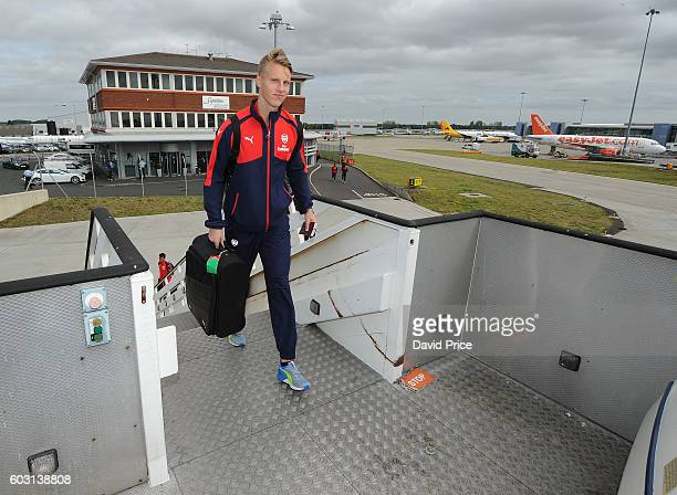 Hugo Keto of Arsenal U19 team boards the plane at Luton Airport on September 12 2016 in Luton England