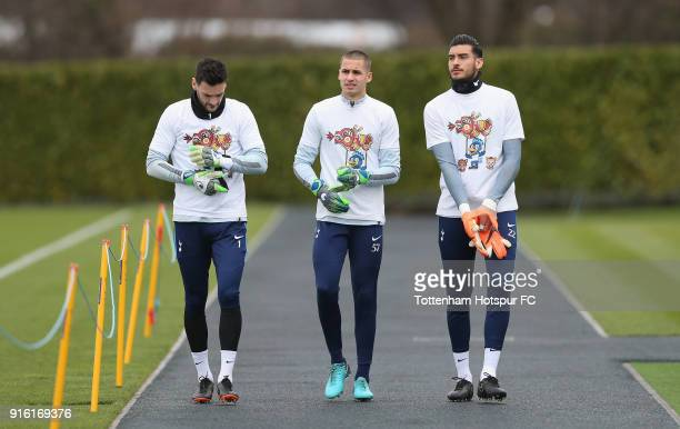 Hugo Lloris Alfie Whiteman and Paulo Gazzaniga of Tottenham Hotspur walk out for training in Chinese New Year tshirts ahead of the north london derby...