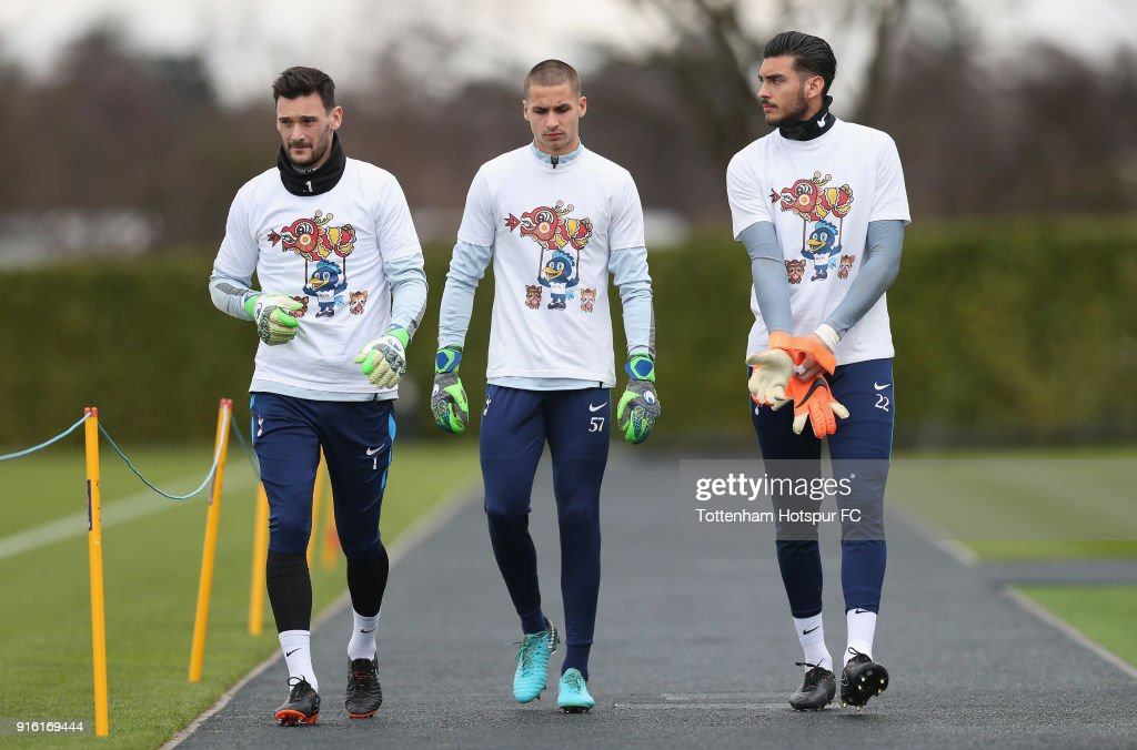 Hugo Lloris, Alfie Whiteman and Paulo Gazzaniga of Tottenham Hotspur walk out for training in Chinese New Year t-shirts ahead of the north london derby during the Tottenham Hotspur training session at Tottenham Hotspur Training Centre on February 9, 2018 in Enfield, England.