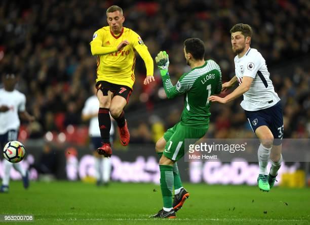 Hugo Lloris and Ben Davies of Tottenham Hotspur clear under pressure from Gerard Deulofeu of Watford during the Premier League match between...