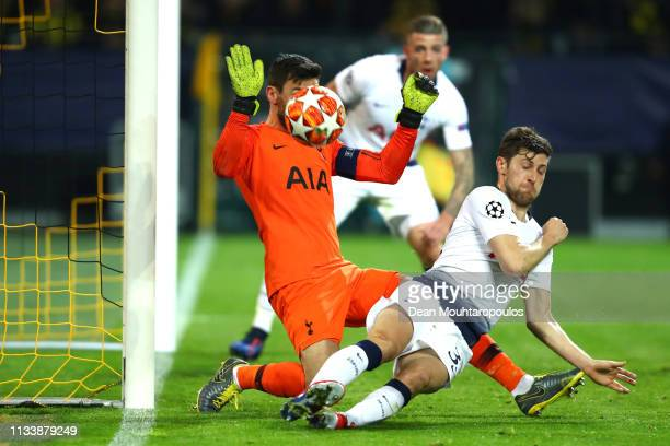 Hugo Lloris and Ben Davies of Tottenham Hotspur make a save in front of the goal during the UEFA Champions League Round of 16 Second Leg match...