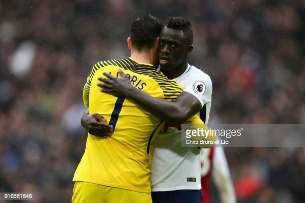 Hugo Lloris and Davinson Sanchez both of Tottenham Hotspur hug after the Premier League match between Tottenham Hotspur and Arsenal at Wembley...