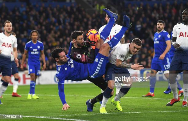 Hugo Lloris and Kieran Trippier of Tottenham Hotspur foil Sean Morrison of Cardiff City during the Premier League match between Cardiff City and...